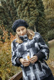 Pregnant young woman in autumn park Royalty Free Stock Photos