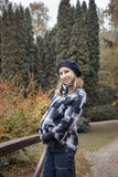 Pregnant young woman in autumn park Stock Photo