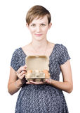 Pregnant young woman displaying a box of eggs Royalty Free Stock Image