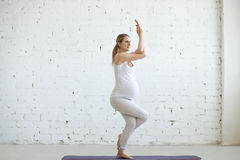 Pregnant young woman doing prenatal yoga. Eagle Pose Royalty Free Stock Images
