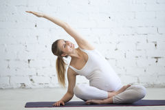 Pregnant young woman doing prenatal yoga. Variation of Easy Post Stock Images