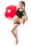 Pregnant young woman  doing yoga on fitball Stock Image