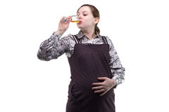 Pregnant young woman drinking alcohol Stock Photos