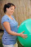 Pregnant young woman exercising with ball Stock Photo