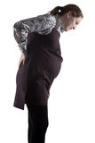 Pregnant young woman and lower back pain. On white background Royalty Free Stock Images