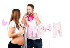 Pregnant young woman with man in studio Royalty Free Stock Photography