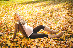 Pregnant young woman meditation outdoors Stock Image
