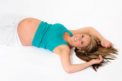 Pregnant young woman relaxing Royalty Free Stock Image