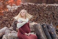 Pregnant young woman. Resting in autumn forest Stock Photos