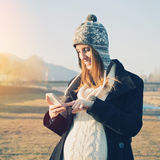 Pregnant young woman with smart phone Royalty Free Stock Image