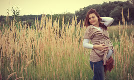 Pregnaut woman. Beautiful young pregnant woman on nature Stock Images
