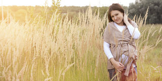 Pregnaut woman. Beautiful young pregnant woman on nature Stock Image