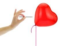 Prego aproximadamente para estalar um balão do coração fotografia de stock royalty free