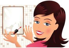 Pregos da pintura da menina com polimento Foto de Stock