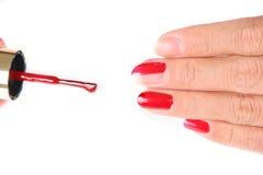 Pregos que estão sendo pintados vermelhos Imagem de Stock Royalty Free
