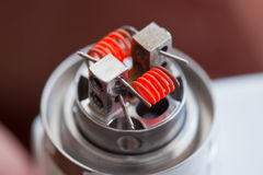 Preheat spiral of clapton coil mounted in the electronic cigarette Stock Photography