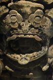 A prehispanic god watching from his ritual mask version 4. A close up of a prehispanic god watching from his ritual mask beutiful combination of color and light stock photo