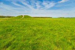 Spring sunny landscape of historic Stonehenge. Prehistoric artificial chalk mound near historic Stonehenge in spring sunny day in England, UK. Beautiful royalty free stock photo