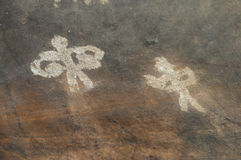 Prehistoric cave painting in Bhimbetka -India. Royalty Free Stock Photo