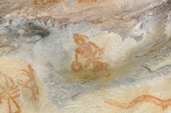 Prehistoric cave painting in Bhimbetka -India. Royalty Free Stock Image