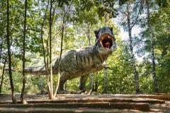 Prehistoric dinosaurs Tyrannosaurus Rex in wildlife. Model of dangerous prehistoric dinosaurs Tyrannosaurus Rex, T-rex in wildlife royalty free stock photos