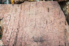 Prehistoric drawing on stone stock photography