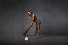 Prehistoric first golfer concept Stock Images