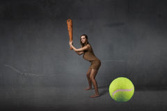 Prehistoric first tennis player concept Royalty Free Stock Image