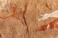Prehistoric Petroglyphs in libian sahara desert. Prehistoric Petroglyphs - Rock Art - Akakus Acacus Mountains, Sahara, Libya stock image