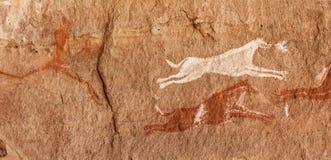 Prehistoric Petroglyphs in libian sahara desert. Prehistoric Petroglyphs - Rock Art - Akakus Acacus Mountains, Sahara, Libya stock photography