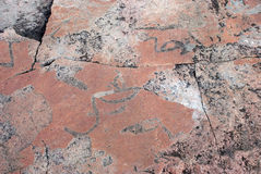 Prehistoric petroglyphs in the North Karelia. Onega, Russia. Mad Stock Image