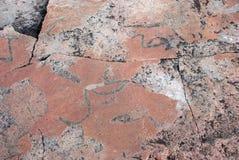Prehistoric petroglyphs in the North Karelia. Onega, Russia. Mad Stock Image