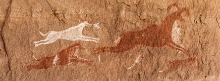 Prehistoric Petroglyphs in libian sahara desert. Prehistoric Petroglyphs - Rock Art - Akakus Acacus Mountains, Sahara, Libya royalty free stock image