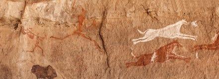 Prehistoric Petroglyphs in libian sahara desert. Prehistoric Petroglyphs - Rock Art - Akakus Acacus Mountains, Sahara, Libya royalty free stock images