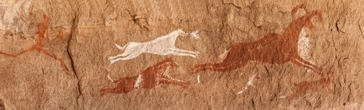 Prehistoric Petroglyphs in libian sahara desert. Prehistoric Petroglyphs - Rock Art - Akakus Acacus Mountains, Sahara, Libya stock images