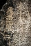 Prehistoric rock carving petroglyphs in Gobustan. Prehistoric rock carving petroglyphs of people, deer and ornaments in Gobustan. Exposition of Petroglyphs in royalty free stock photos