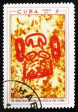 Prehistoric rock paintings, the series `The 30th Anniversary of The Cuban Speleological Society`, circa 1970. MOSCOW, RUSSIA - JULY 15, 2017: A stamp printed in royalty free stock photo