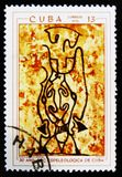 Prehistoric rock paintings, the series `The 30th Anniversary of The Cuban Speleological Society`, circa 1970. MOSCOW, RUSSIA - JULY 15, 2017: A stamp printed in stock image