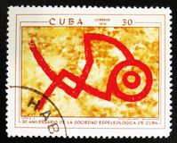 Prehistoric rock paintings, the series `The 30th Anniversary of The Cuban Speleological Society`, circa 1970. MOSCOW, RUSSIA - JULY 15, 2017: A stamp printed in royalty free stock image