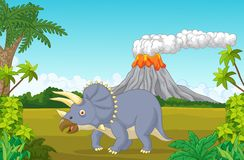 Prehistoric scene with triceratops cartoon and volcano Royalty Free Stock Image