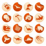 Prehistoric stickers. Prehistoric symbols on round stickers Stock Image