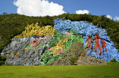 Prehistory mural in Viñales Valley (Pinar del Rio, Cuba). Vinales, Cuba - September 6, 2015: Colorful painting on a cliff in Vinales Valley (Cuba Stock Photo