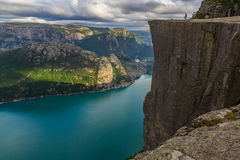 Preikestolen - landscape of tourists at the top of spectacular Pulpit Rock cliff and surrounding fjords, Norway. Preikestolen or Prekestolen Preacher`s Pulpit or Stock Image