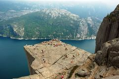 Preikestolen. Or Prekestolen, also known by the English translations of Preacher's Pulpit or Pulpit Rock is a massive cliff 604 metres above Lysefjorden. It is Royalty Free Stock Photo