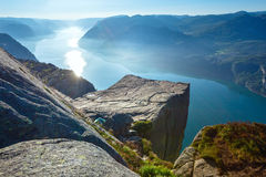 Preikestolen massive cliff top (Norway). Preikestolen massive cliff (Norway, Lysefjorden summer morning view Royalty Free Stock Photography