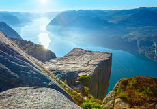 Preikestolen massive cliff top (Norway). Preikestolen massive cliff (Norway, Lysefjorden summer morning view Stock Photo