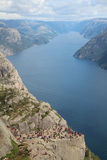 Preikestolen, Norway. Preikestolen or Prekestolen, Preacher's Pulpit or Pulpit Rock, is a famous tourist attraction in Forsand, Ryfylke, Norway Stock Photos