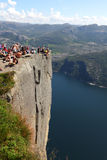 Preikestolen rock cliff at fjord with tourists Royalty Free Stock Photos