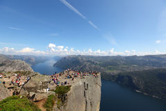 Preikestolen rock cliff at fjord with visitors hik Stock Images