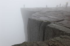 Preikestolen rock taken in deep fog, Norway fjord Royalty Free Stock Images